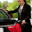 Woman refuel car — Lizenzfreies Foto