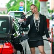 Woman in gas station — Foto Stock