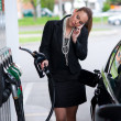Elegant womin gas station — Stock Photo #19794859