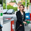 Elegant womin gas station — Stock Photo #19795099