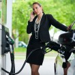 Woman in gas station — Stock Photo #19795113