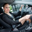 Woman driving and changing radio station — Stock Photo #19795547