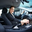 Stock Photo: Attractive womdriving car