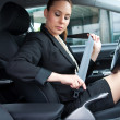Woman puting safety belt on - Stockfoto
