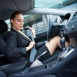 Woman puting safety belt — Foto de Stock