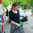 Woman in gas station — Stock Photo