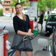 Stock Photo: Womin gas station