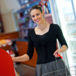 Woman shoping in store — Stock Photo