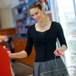 Woman shoping in store — Stock Photo #19799755