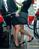 Two girlfriends on gas station — Stock Photo