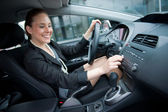 Woman driving and changing radio station — Stock Photo