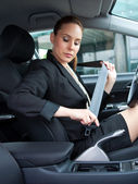 Woman puting safety belt on — Stockfoto