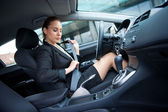 Woman puting safety belt — Stockfoto