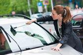 Woman washing car window — Stock Photo