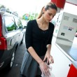 Woman with protective gloves on gas station — Stok fotoğraf