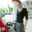 Woman refuel her car — Stock Photo