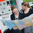 Stock Photo: Two womlooking at map
