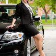 Stock Photo: Womat her car