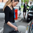 Woman refuel her car — Stock Photo #19800759