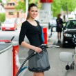 Woman in petrol station - Stock Photo