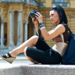 Stock Photo: Womtourist with camera