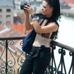 Woman tourist at city view — Stock Photo #19805163