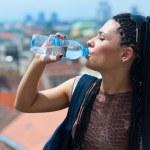 Woman drinks water — Stock Photo #19805301