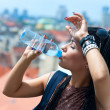Woman drinks water - Stock Photo