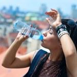 Woman drinks water — Stock Photo #19805353