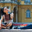 Woman tourist cooling herself — Stock Photo #19805875