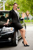 Woman at her car — Stock Photo