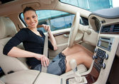 Woman and safety belt in the car — Foto Stock