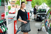 Woman in petrol station — Stock Photo