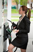 Woman at gas station — Stock Photo