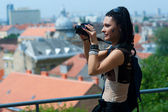 Woman tourist with camera — Stock Photo