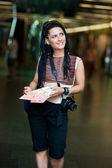 Woman tourist with camera — Stock Photo
