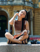 Woman tourist cooling herself — Stock Photo