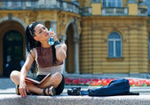 Woman tourist cooling herself — Stock Photo