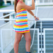 Foto Stock: Thirsty rollerskate girl