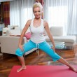 Woman exercise in her home — Stockfoto #20349209