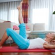 Woman exercise in her home — ストック写真