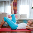 Woman exercise in her home — Stock fotografie