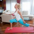 Woman exercise in her home — Stockfoto