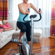 图库照片: Woman on stationary bicycle