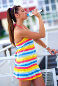 Teen girl drinks water — Stock Photo