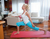 Woman exercise in her home — Stock Photo