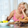 Tired woman at breakfast — Stock Photo #20350385