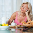 Tired woman at breakfast — Stock Photo #20350415