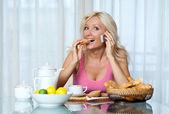 Woman at breakfast — Stock Photo