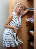 Woman choosing shoes — Stock Photo
